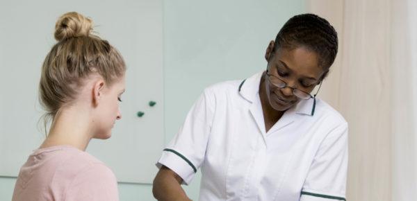 a nurse with a patient
