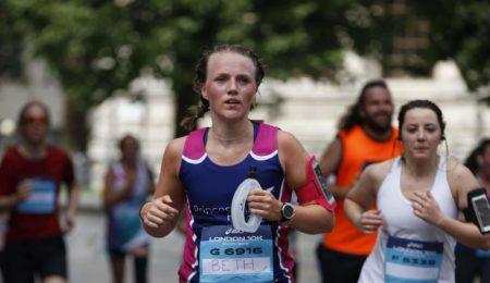 ASICS runner in PAH vest