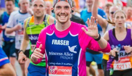 Smiling runner in London Marathon wearing PAH vest