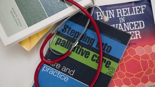 Palliative care text books and a stethoscope