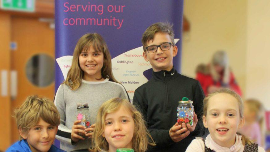 school pupils with decorated jam jars