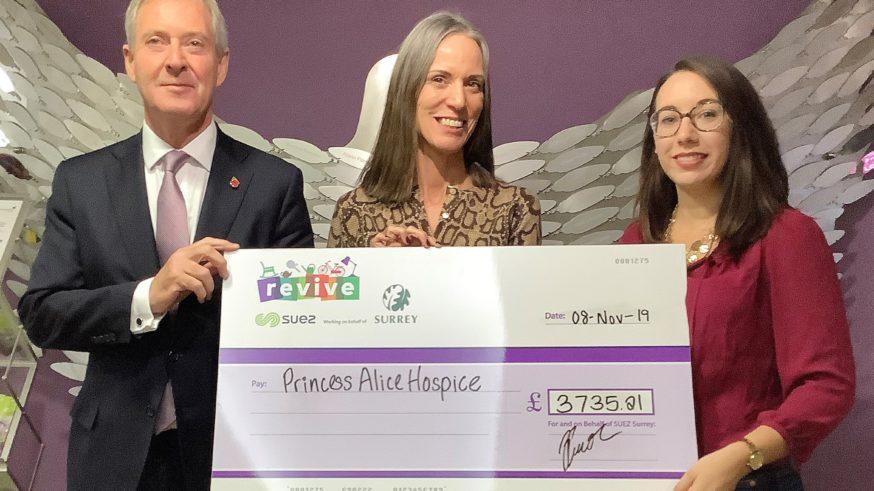 Princess Alice Hospice Nicki CEO Nicki Shaw, holding a cheque for £3735.21, alongside Tim Oliver and Kacie Thompson