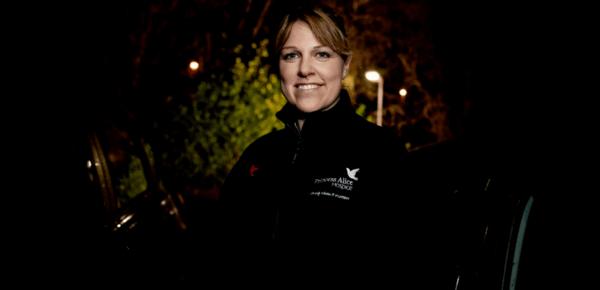 Rebecca Night nurse with PAH fleece outside at night
