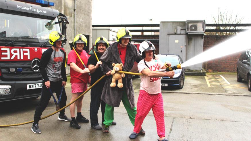 Firefighters posing in their PJs