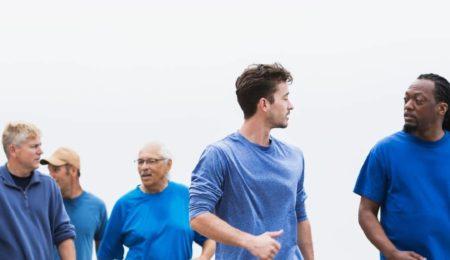 Men walking alongside each other